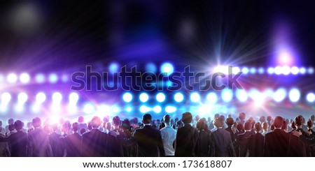 Crowd of businesspeople standing with back with lights at background #173618807