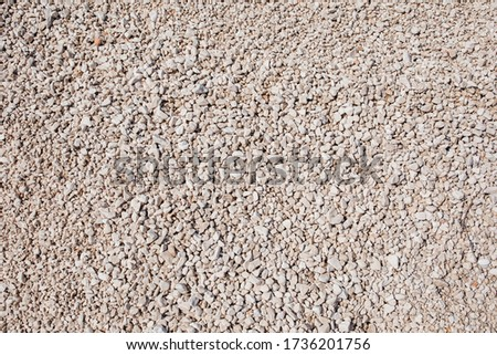 Pebbles background. White pebble stones texture and background.White pebbles abstract background. Pebble beach. Summer vacation with empty space for text. Construction material #1736201756