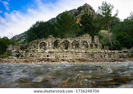 Ruins of Olympos (Olympus) Ancient Cİty. Cirali beach. Antalya, Turkey. Travel and tourism background. Royalty-Free Stock Photo #1736248706