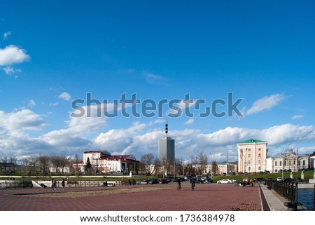Russia, Arkhangelsk, spring - May 2020. The attraction of the city is a high-rise building, the only and first skyscraper in the regional center. Spring city with bare trees and blue sky with white #1736384978