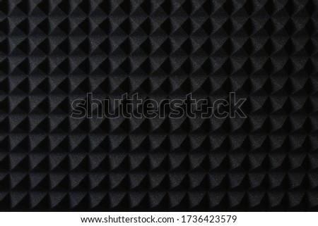 Pattern of professional black foam in a music audio studio, background