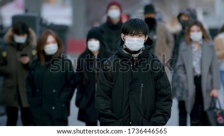 Corona Virus Flu Asia. Wearing Respiratory protection Face Masks Korea. Korean City Street Crowd Walk real. Asian Covid-19 Coronavirus Mers. Chinese People. Lockdown 2019-ncov China. Covid19. Royalty-Free Stock Photo #1736446565