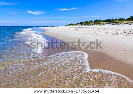 Beautiful sandy beach on Hel Peninsula, Baltic sea, Pomeranian Voivodeship, Poland. Hel is a 35-km-long sand bar peninsula in northern Poland separating the Bay of Puck from the open Baltic Sea Royalty-Free Stock Photo #1736661464