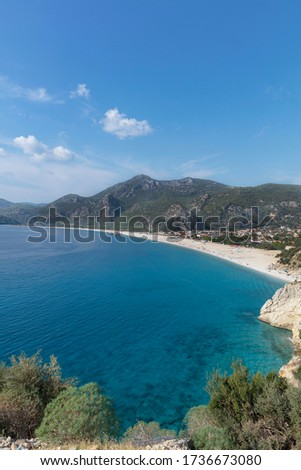 Oludeniz  beach. Fethiye is one of the most popular beaches of  mediteranean sea with its clean beach and sea.  Royalty-Free Stock Photo #1736673080