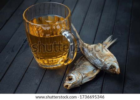 Beer and salted fish. Dried roach for beer. Appetizer to alcohol. Rich color of alcohol. Beer mug