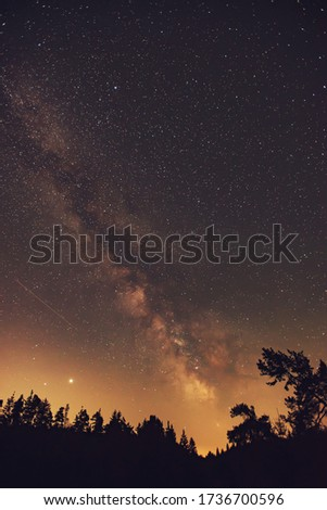 Spring Milky Way and satellite light in the night sky.