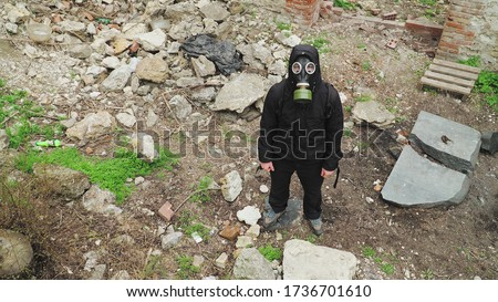 man in gas mask abandoned destroyed building. man-made disaster. technogenic catastrophe. ecological catastrophe. Post apocalyptic world. Stalker concept survivor after nuclear chemical war. Top view. Royalty-Free Stock Photo #1736701610