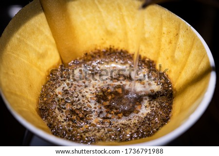 Closeup picture of soft roasted coffee in a drip cone