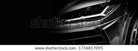 Detail on one of the LED headlights super car.copy space #1736817095