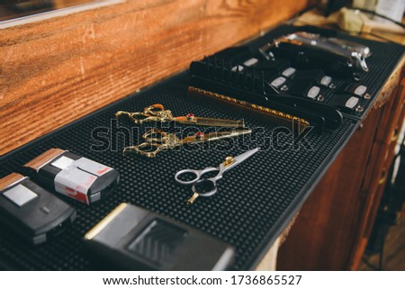Professional tools of hairdresser. Barber set with tools, equipment and cosmetics. #1736865527
