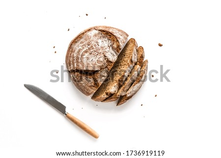 Fresh Sourdough Bread isolated on white background. Fresh baked homemade sliced rye bread, top view, copy space. #1736919119