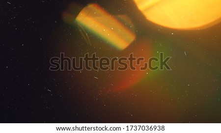 Rainbow Lens Optical Flare Film Dust Overlay Effect Vintage Abstract Bokeh Light Leaks Photo Retro Camera Defocused Blur Reflection Bright Sunlights. Use Screen Overlay Mode for Photo Processing. Royalty-Free Stock Photo #1737036938
