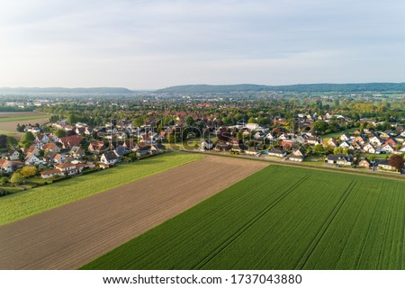 Small settlement with houses in rural areas, Germany Royalty-Free Stock Photo #1737043880