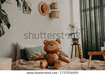 Balloon in the form of a bear. Colorful balloons in the form of images of cartoon characters. Toy bear made from balloons for children