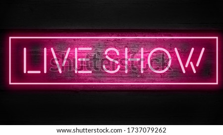 LIVE SHOW phrase in  pink neon style on wooden background for your design tempates.
