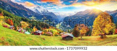 Fabulous autumn view of picturesque alpine Wengen village and Lauterbrunnen Valley with Jungfrau Mountain and  on background. Location: Wengen village, Berner Oberland, Switzerland, Europe. #1737099932