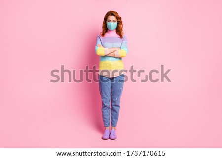 Full size photo of pretty foxy lady keep social distance good mood hold arms crossed queue up pharmacy wear protect face mask jeans striped pullover shoes isolated pink color background #1737170615