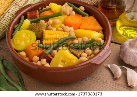 Photographic food still life with a typical Canarian stew in a clay pot Royalty-Free Stock Photo #1737360173