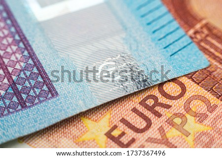 Macro photograph of the word euro on a euro banknote. European monetary system. The ECB prints money and buys bonds. Danger of inflation