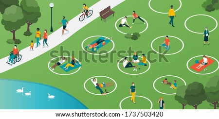 Social distancing circles in the city park and people relaxing safely outdoors, coronavirus covid-19 prevention Royalty-Free Stock Photo #1737503420