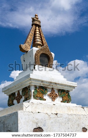 Battered, cracked and stained stupa - buddhist symbol of enlightenment and mind, found in the voids of mongolian steppe. #1737504737