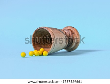 Several yellow pills fell from a vessel on a blue background #1737529661