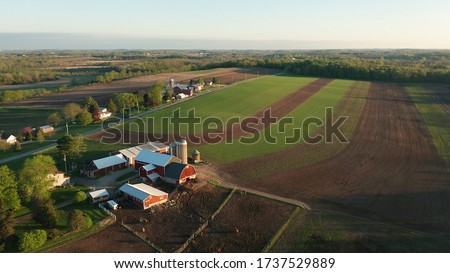 Aerial view of american countryside landscape. Farm, red barn, cows. Rural scenery, farmland. Sunny morning, spring summer season   Royalty-Free Stock Photo #1737529889
