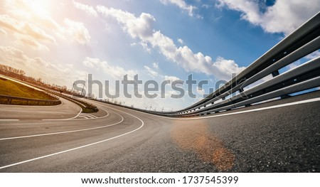 Race Car / motorcycle racetrack after rain on a sunny day. Fast motion blur effect. Ready to race Royalty-Free Stock Photo #1737545399