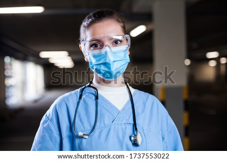 Frontline medical worker working long night shifts in EMS clinic or Coronavirus mobile testing center,COVID-19 pandemic causing stress  sleep deprivation,overworked tired exhausted hospital ICU staff Royalty-Free Stock Photo #1737553022