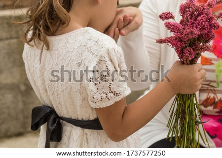 Celebrate the victim feast of the elders on the religious Ramadan Eid holidays.happy mother and teachers day.kiss the mum hand.