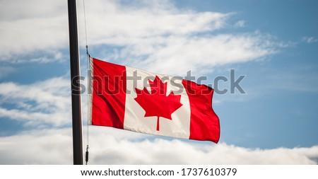 Canadian Flag Waving At Half-mast Royalty-Free Stock Photo #1737610379
