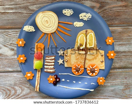 Picture of food, for a child for Breakfast, DIY car on the road with traffic lights, sun and flowers.