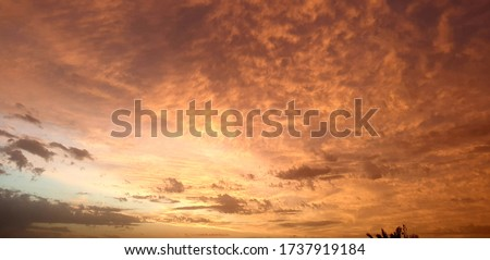 an evening pic of clouds when sun was going to set and all sky became red. neture is so beautiful.