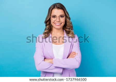 Portrait of her she nice attractive lovely successful cheerful cheery wavy-haired girl folded arms isolated over bright vivid shine vibrant blue color background Royalty-Free Stock Photo #1737966500