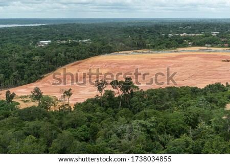 View to deforested area on green Amazon rainforest near Manaus