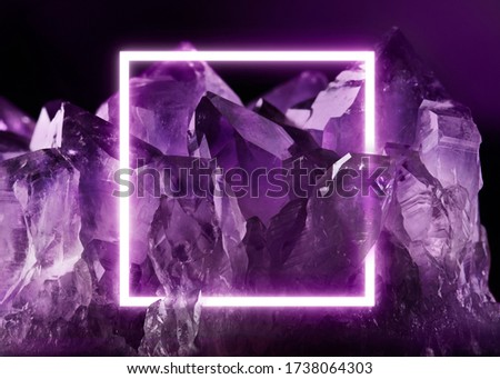 Creative fluorescent layout made of crystal. Neon light flat square frame on transparent purple amethyst crystal, dark purple colors.