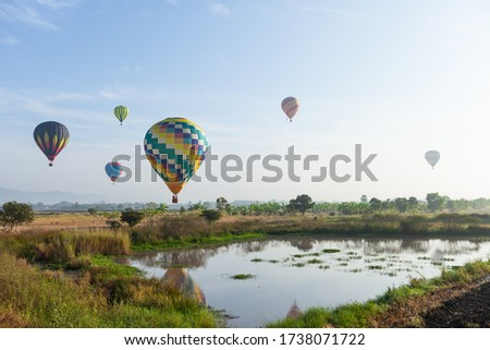 Bright hot air balloon in the sky #1738071722