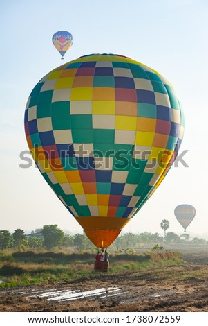 Bright hot air balloon in the sky #1738072559