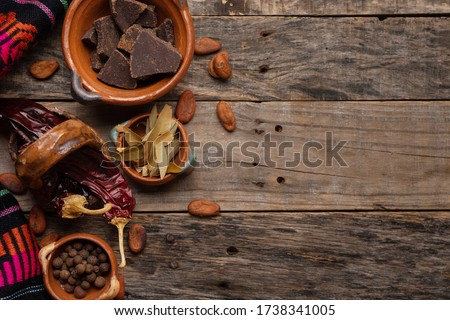 Traditional mexican ingredients for mole sauce on wooden background #1738341005