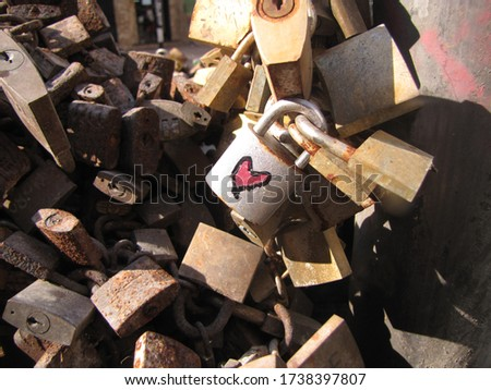 Detail of a red heart drawn on a padlock in the fountain of the padlocks, city of Montevideo. Tradition of closing metal padlocks to seal the love of couples by the sun.