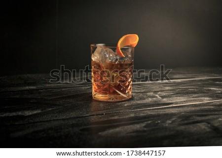 Old fashion with an orange twist Royalty-Free Stock Photo #1738447157