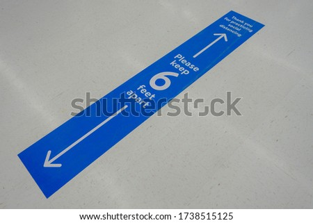 Business floor with 6feet blue and white social distancing message