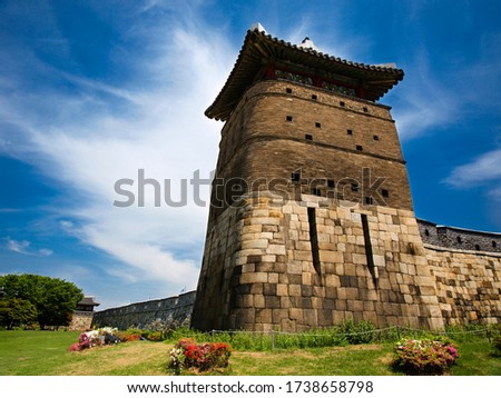Ancient tower and ramparts walls of the UNESCO heritage site during beautiful day, Suwon, South Korea #1738658798