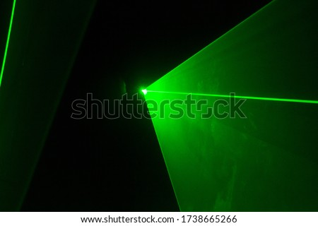 Abstract of digital green light laser line, disco light show, stage lights with laser.Green laser beams light effect on black background.Green light beam from lens projector on black background Royalty-Free Stock Photo #1738665266