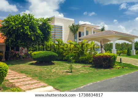 Luxurious villa in Dominican Republic. Beautiful villa with an own swimming pool. villa on luxury Caribbean resort with beautiful garden. Classical spanish villa among flowers, not far from ocean. #1738834817