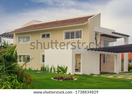 Luxurious villa in Dominican Republic. Beautiful villa with an own swimming pool. villa on luxury Caribbean resort with beautiful garden. Classical spanish villa among flowers, not far from ocean. #1738834829
