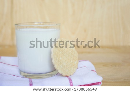 Delicious fresh milk on a white wooden background. A bottle of milk and a glass of milk. breakfast. copy space