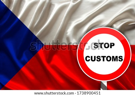 customs sign, stop, attention on the background of the silk national flag of the Czech Republic, the concept of border and customs control, violation of the state border, tourism restrictions