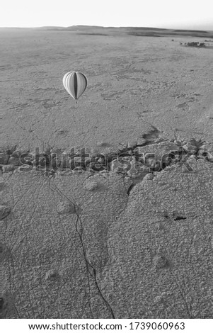 Picture from a hot air balloon of another hot air balloon, Taken in the Masai Mara, Kenya in 2010