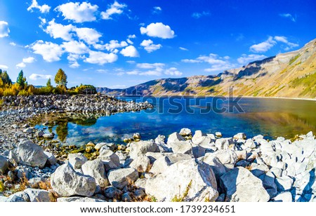 Mountain lake water rocks view. Mountain lake rocky beach landscape #1739234651